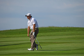 NEWPORT, WALES - JUNE 04:  Graeme McDowell of Northern Ireland reacts to his approach to the 18th green during the third round of the Saab Wales Open on the Twenty Ten course at The Celtic Manor Resort on June 4, 2011 in Newport, Wales.  (Photo by Richard