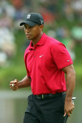 BETHESDA, MD - JULY 05:  Tiger Woods reacts to his shot during the final round of the AT&T National hosted by Tiger Woods at Congressional Country Club on July 5, 2009 in Bethesda, Maryland.  (Photo by Hunter Martin/Getty Images)