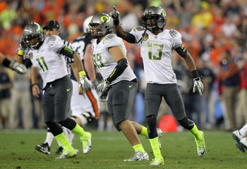 GLENDALE, AZ - JANUARY 10:  Cliff Harris #13 of the Oregon Ducks reacts during their game against the Auburn Tigers during the Tostitos BCS National Championship Game at University of Phoenix Stadium on January 10, 2011 in Glendale, Arizona.  (Photo by Jo