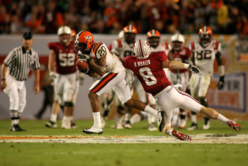 MIAMI, FL - JANUARY 03:  Jayron Hosley #20 of the Virginai Tech Hokies intercepts a pass in the second quarter against Ryan Whalen #8 of the Stanford Cardinal during the 2011 Discover Orange Bowl at Sun Life Stadium on January 3, 2011 in Miami, Florida.