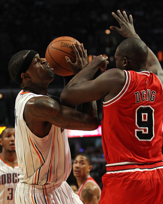 CHICAGO, IL - FEBRUARY 15: Stephen Jackson #1 of the Charlotte Bobcats is fouled by Loul Deng #9 of the Chicago Bulls at the United Center on February 15, 2011 in Chicago, Illinois. NOTE TO USER: User expressly acknowledges and agrees that, by downloading