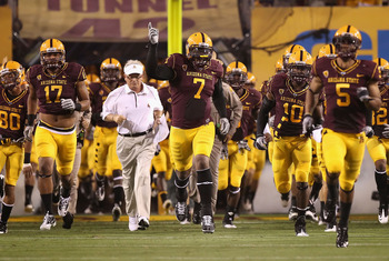TEMPE, AZ - SEPTEMBER 04:  (L-R) Gregory Smith #17, head coach Dennis Erickson, Vontaze Burfict #7 and Keelan Johnson #10 of the Arizona State Sun Devils lead teammates out onto the field prior the college football game against the Portland State Vikings