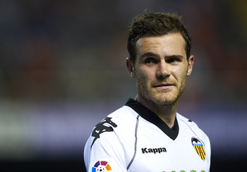 VALENCIA, SPAIN - APRIL 10:  Juan Mata of Valencia looks on during the La Liga match between Valencia and Villarreal at Estadio Mestalla on April 10, 2011 in Valencia, Spain.  Valencia won 5-0.  (Photo by Manuel Queimadelos Alonso/Getty Images)