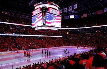 WASHINGTON - MAY 04:  General view of the on ice display of an American Flag during the National Anthem prior to the start of a NHL game between the Washington Capitals and the Pittsburgh Penguins during Game Two of the Eastern Conference Semifinal Round