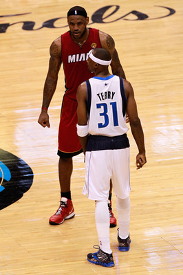 DALLAS, TX - JUNE 07: LeBron James #6 of the Miami Heat and Jason Terry #31 of the Dallas Mavericks stand on court in Game Four of the 2011 NBA Finals at American Airlines Center on June 7, 2011 in Dallas, Texas. The Mavericks won 86-83. NOTE TO USER: Use