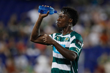 HARRISON, NJ - JULY 23:  Yannick Djalo #20 of Sporting Lisbon cools off during a match against Manchester City in the Barclays New York Challenge July 23, 2010 at Red Bull Arena in Harrison, New Jersey. Sporting Lisbon defeats Manchester City 2-0.  (Photo