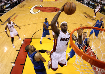 MIAMI, FL - MAY 31:  LeBron James #6 of the Miami Heat dunks the ball over Tyson Chandler #6 of the Dallas Mavericks in the fourth quarter in Game One of the 2011 NBA Finals at American Airlines Arena on May 31, 2011 in Miami, Florida. NOTE TO USER: User