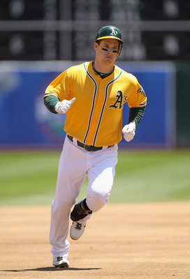 OAKLAND, CA - JUNE 01:  Josh Willingham #16 of the Oakland Athletics rounds the bases after he hit a two run home run in the first inning against the New York Yankees at Oakland-Alameda County Coliseum on June 1, 2011 in Oakland, California.  (Photo by Ez