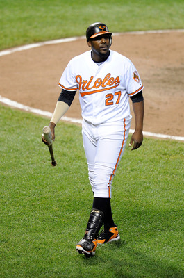BALTIMORE, MD - JUNE 11:  Vladimir Guerrero #27 of the Baltimore Orioles walks to the dugout after striking out against the Tampa Bay Rays at Oriole Park at Camden Yards on June 11, 2011 in Baltimore, Maryland.  (Photo by Greg Fiume/Getty Images)