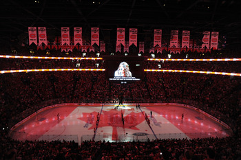 MONTREAL, QC - MAY 22:  Fans and players stand at attention as the Canadian National Anthem is perform prior to the start of Game 4 of the Eastern Conference Finals during the 2010 NHL Stanley Cup Playoffs at Bell Centre on May 22, 2010 in Montreal, Canad