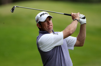 VIRGINIA WATER, ENGLAND - MAY 28:  Lee Westwood of England  hoits an approach shot during the third round of the BMW PGA Championship at the Wentworth Club on May 28, 2011 in Virginia Water, England.  (Photo by Warren Little/Getty Images)