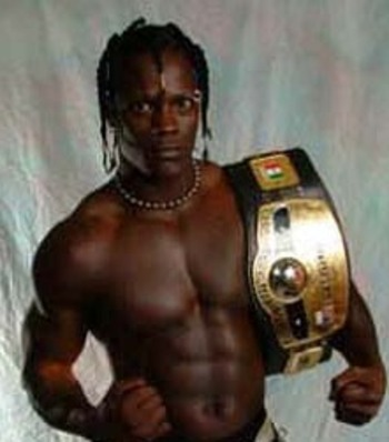 "Ron ""The Truth"" Killings with his NWA World Heavyweight Title"