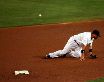 Florida Second baseman Omar Infante misses a routine ground ball during the Marlins recent losing streak