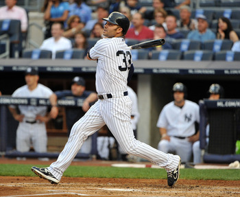 NEW YORK, NY - JUNE 10: Nick Swisher #33 of the New York Yankees watches his RBI sacrifice fly in the bottom of the first inning against the Cleveland Indians on June 10, 2011 at Yankee Stadium in the Bronx borough of New York City. (Photo by Christopher