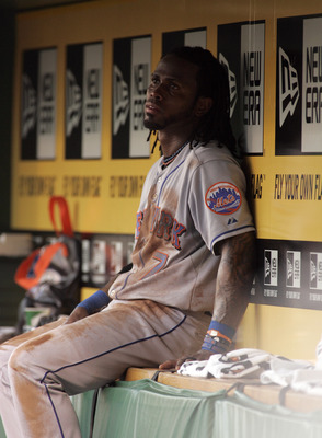 PITTSBURGH, PA - JUNE 11:  Jose Reyes #7 of the New York Mets looks on from the dugout against the Pittsburgh Pirates during the game on June 11, 2011 at PNC Park in Pittsburgh, Pennsylvania.  (Photo by Justin K. Aller/Getty Images)