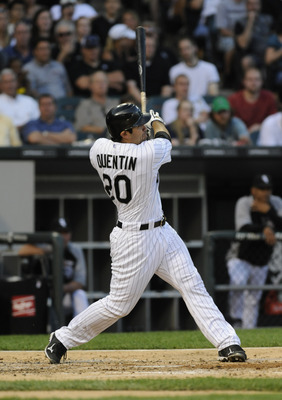 CHICAGO, IL - JUNE 07: Carlos Quentin # 20 of the Chicago White Sox hits a two-run homer against the Seattle Mariners in the third inning on June 7, 2011 at U.S. Cellular Field in Chicago, Illinois.  (Photo by David Banks/Getty Images)