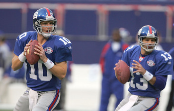 EAST RUTHERFORD, NJ - NOVEMBER 21:  Eli Manning #10 and Kurt Warner #13 of the New York Giants drop back to pass during warm ups before their game against the Atlanta Falcons at Giant Stadium on November 21, 2004 in East Rutherford, New Jersey. (Photo by
