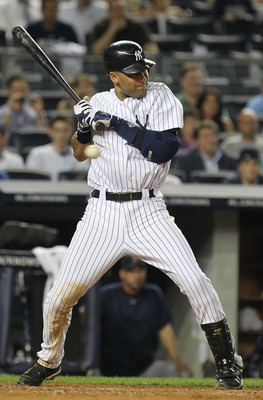 NEW YORK, NY - JUNE 08:  Derek Jeter #2 of the New York Yankees avoids getting hit by a pitch during the game against the Boston Red Sox on June 8, 2011 at Yankee Stadium in the Bronx borough of New York City.  (Photo by Al Bello/Getty Images)