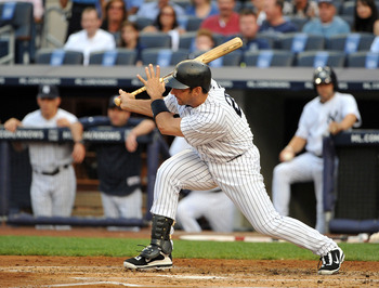NEW YORK, NY - JUNE 10: Jorge Posada #20 of the New York Yankees connects for an RBI single in the bottom of the first inning against the Cleveland Indians on June 10, 2011 at Yankee Stadium in the Bronx borough of New York City. (Photo by Christopher Pas