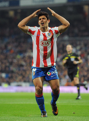 MADRID, SPAIN - JANUARY 13: Sergio Aguero of Atletico Madrid reacts during the Copa del Rey quarter final first leg match between Real Madrid and Atletico Madrid at Estadio Santiago Bernabeu on January 13, 2011 in Madrid, Spain.  (Photo by Denis Doyle/Get
