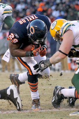 CHICAGO, IL - JANUARY 23:  Running back Chester Taylor #29 of the Chicago Bears scores a one-yard fourth quarter touchdown against the Green Bay Packers in the NFC Championship Game at Soldier Field on January 23, 2011 in Chicago, Illinois.  (Photo by Dou