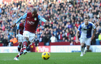 BIRMINGHAM, ENGLAND - FEBRUARY 26:  Ashley Young of Aston Villa scores from the penalty spot during the Barclays Premier League match between Aston Villa and Blackburn Rovers at Villa Park on February 26, 2011 in Birmingham, England.  (Photo by Laurence G