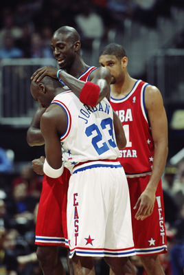 ATLANTA - FEBRUARY 9:  Kevin Garnett (Minnesota Timberwolves) #21 of the Western Conference All-Stars greets Michael Jordan (Washington Wizards) #23 of the Eastern Conference All-Stars before the 2003 NBA All-Star Game on February 9, 2003 at Philips Arena