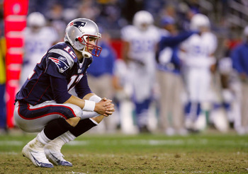 FOXBORO, MA - NOVEMBER 07:  Quarterback Tom Brady #12 of the New England Patriots sits dejected on the field after their 40-21 loss to the Indianapolis Colts at Gillette Stadium on November 7, 2005 in Foxboro, Massachusetts.  (Photo by Nick Laham/Getty Im
