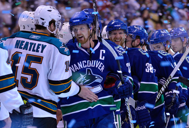 VANCOUVER, CANADA - MAY 24:  Captain Henrik Sedin #33 of the Vancouver Canucks shakes hands with Dany Heatley #15 of the San Jose Sharks after the Vancouver Canucks won Game Five of the Western Conference Finals 3-2 in the second overtime to win the serie