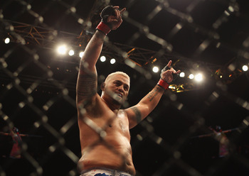 SYDNEY, AUSTRALIA - FEBRUARY 27:   Mark Hunt of Australia celebrates his win over Chris Tuchscherer of the United States during their heavyweight bout as part of UFC 127 at Acer Arena on February 27, 2011 in Sydney, Australia.  (Photo by Mark Kolbe/Getty