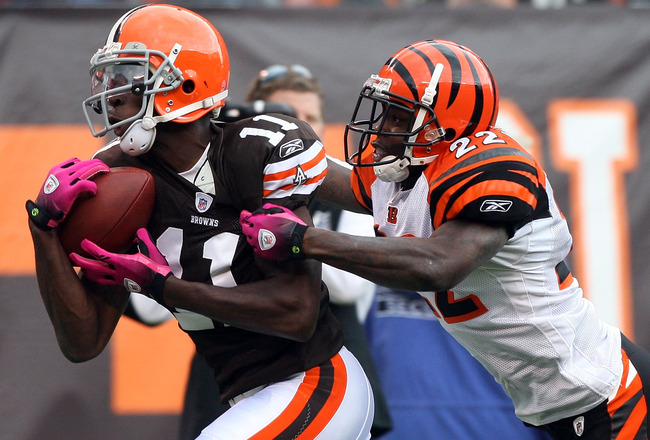 CLEVELAND - OCTOBER 04: Mohamed Massaquoi #11 of the Cleveland Browns makes a catch at the 1 yard line against Jonathan Joseph #22 of the Cincinnati Bengals during their game at Cleveland Browns Stadium on October 4, 2009 in Cleveland, Ohio.  (Photo by Ji