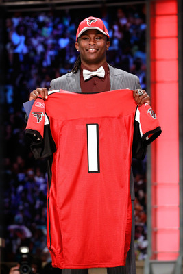 NEW YORK, NY - APRIL 28:  Julio Jones, #6 overall pick by the Atlanta Falcons, holds up a jersey on stage during the 2011 NFL Draft at Radio City Music Hall on April 28, 2011 in New York City.  (Photo by Chris Trotman/Getty Images)
