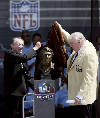 CANTON, OH - AUGUST 5: Oakland Raiders owner Al Davis (L) and former Broadcaster and former Oakland Raider coach John Madden unveil his bust during the Class of 2006 Pro Football Hall of Fame Enshrinement Ceremony at Fawcett Stadium on August 5, 2006 in C