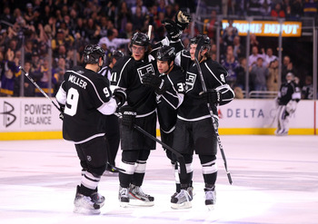 LOS ANGELES, CA - MARCH 24:  Willie Mitchell #33 of the Los Angeles Kings celebrates his goal with teammates Oscar Moller #9, Anze Kopitar #11 and Drew Doughty #8 in the second period during the NHL game against the San Jose Sharks at Staples Center on Ma