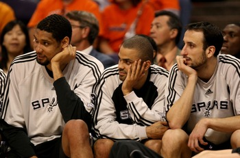 PHOENIX - APRIL 27:  Tim Duncan #21, Tony Parker #9 and Manu Ginobili #20 of the San Antonio Spurs sit on the bench against the Phoenix Suns during Game Four of the Western Conference Quarterfinals during the 2008 at NBA Playoffs at U.S. Airways Center Ap