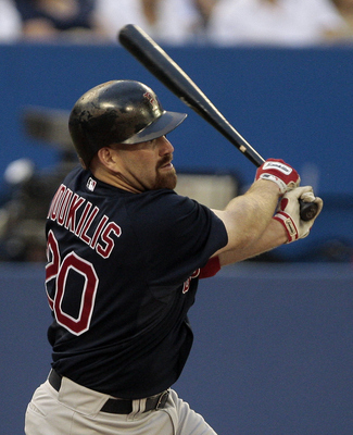 TORONTO, CANADA - JUNE 10:  Kevin Youkilis #20 of the Boston Red Sox hits during MLB action against the Toronto Blue Jays at The Rogers Centre June 10, 2011 in Toronto, Ontario, Canada. (Photo by Abelimages/Getty Images)