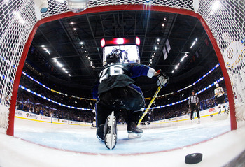 TAMPA, FL - MAY 25:  The puck shot by Steven Stamkos #91 of the Tampa Bay Lightning for a third period goal is seen in the net as Martin St. Louis #26 of the Tampa Bay Lightning climbs out in Game Six of the Eastern Conference Finals against the Boston Br