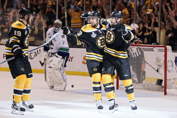 BOSTON, MA - JUNE 08:  Michael Ryder #73 of the Boston Bruins celebrates with his teammates Chris Kelly #23 and Tyler Seguin #19 after scoring a goal in the second period against Roberto Luongo #1 of the Vancouver Canucks during Game Four of the 2011 NHL