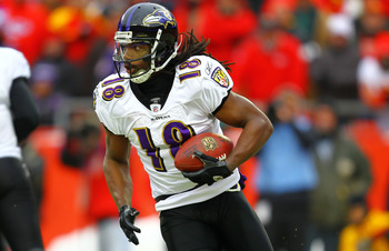 KANSAS CITY, MO - JANUARY 09:  Wide receiver Donte' Stallworth #18 of the Baltimore Ravens runs with the ball on a reverse against the Kansas City Chiefs during their 2011 AFC wild card playoff game at Arrowhead Stadium on January 9, 2011 in Kansas City,