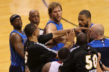 MIAMI, FL - JUNE 12:  Jason Terry #31 (L), Dirk Nowitzki (C) #41 and Brian Cardinal (R) #35 of the Dallas Mavericks attempt to seperate teammate Tyson Chandler (R) #6 of the Dallas Mavericks and Juwan Howard #5 of the Miami Heat on the court in the second