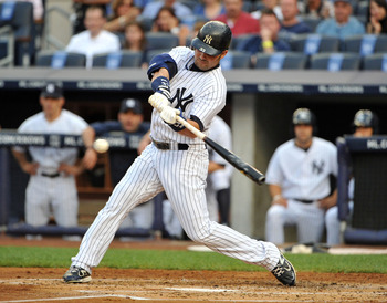 NEW YORK, NY - JUNE 10: Nick Swisher #33 of the New York Yankees connects for an RBI sacrifice fly in the bottom of the first inning against the Cleveland Indians on June 10, 2011 at Yankee Stadium in the Bronx borough of New York City. (Photo by Christop