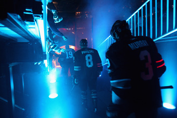 SAN JOSE, CA - MAY 12:  Joe Thornton #19, Joe Pavelski #8 and Douglas Murray #3 of the San Jose Sharks walk on to the ice for their game against the Detroit Red Wings in Game Seven of the Western Conference Semifinals during the 2011 NHL Stanley Cup Playo
