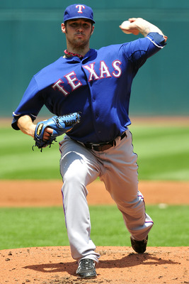 CLEVELAND, OH - JUNE 5: C.J. Wilson #36 of the Texas Rangers pitches during the second inning against the Cleveland Indians at Progressive Field on June 5, 2011 in Cleveland, Ohio. (Photo by Jason Miller/Getty Images)