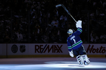 VANCOUVER, BC - JUNE 01:  Roberto Luongo #1 of the Vancouver Canucks celebrates after defeating the Boston Bruins in game one of the 2011 NHL Stanley Cup Finals at Rogers Arena on June 1, 2011 in Vancouver, Canada.  (Photo by Harry How/Getty Images)