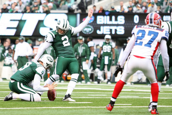 EAST RUTHERFORD, NJ - JANUARY 02:  Nick Folk #2 kicks as Steve Weatherford #9 of the New York Jets holds against the Buffalo Bills at New Meadowlands Stadium on January 2, 2011 in East Rutherford, New Jersey.  (Photo by Michael Heiman/Getty Images)