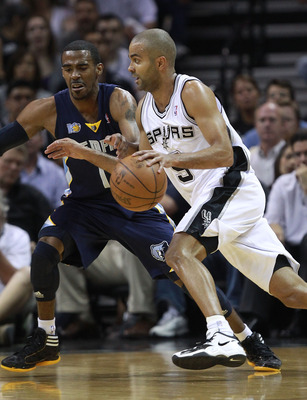 SAN ANTONIO, TX - APRIL 27:  Tony Parker #9 of the San Antionio Spurs drives against Mike Conley #11 of the Memphis Grizzlies in Game Five of the Western Conference Quarterfinals in the 2011 NBA Playoffs on April 27, 2011 at AT&T Center in San Antonio, Te