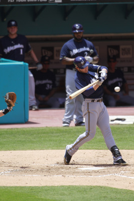 MIAMI GARDENS, FL - JUNE 05:  Ryan Braun #8 of the Milwaukee Brewers bats as teammates Prince Fielder and Corey Hart sit on deck against the Florida Marlins at Sun Life Stadium on June 5, 2011 in Miami Gardens, Florida. The Brewers defeated the Marlins 6-