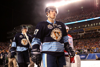 PITTSBURGH, PA - JANUARY 01:  Captain Sidney Crosby #87 of the Pittsburgh Penguins walks out to the ice before playing against the Washington Capitals duringf the 2011 NHL Bridgestone Winter Classic at Heinz Field on January 1, 2011 in Pittsburgh, Pennsyl