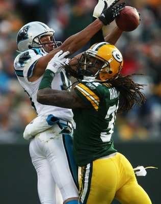 GREEN BAY, WI - NOVEMBER 18: Drew Carter #18 of the Carolina Panthers makes a catch as Al Harris #31 of the Green Bay Packers defends on November 18, 2007 at Lambeau Field in Green Bay, Wisconsin. The Packers defeated the Panthers 31-17. (Photo by Jonatha