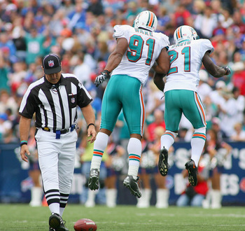 ORCHARD PARK, NY - SEPTEMBER 12: Cameron Wake #91 and Vontae Davis #21 of the Miami Dolphins celebrate a sack against the Buffalo Bills  during the NFL season opener at Ralph Wilson Stadium on September 12, 2010 in Orchard Park, New York.  Miami won 15-10